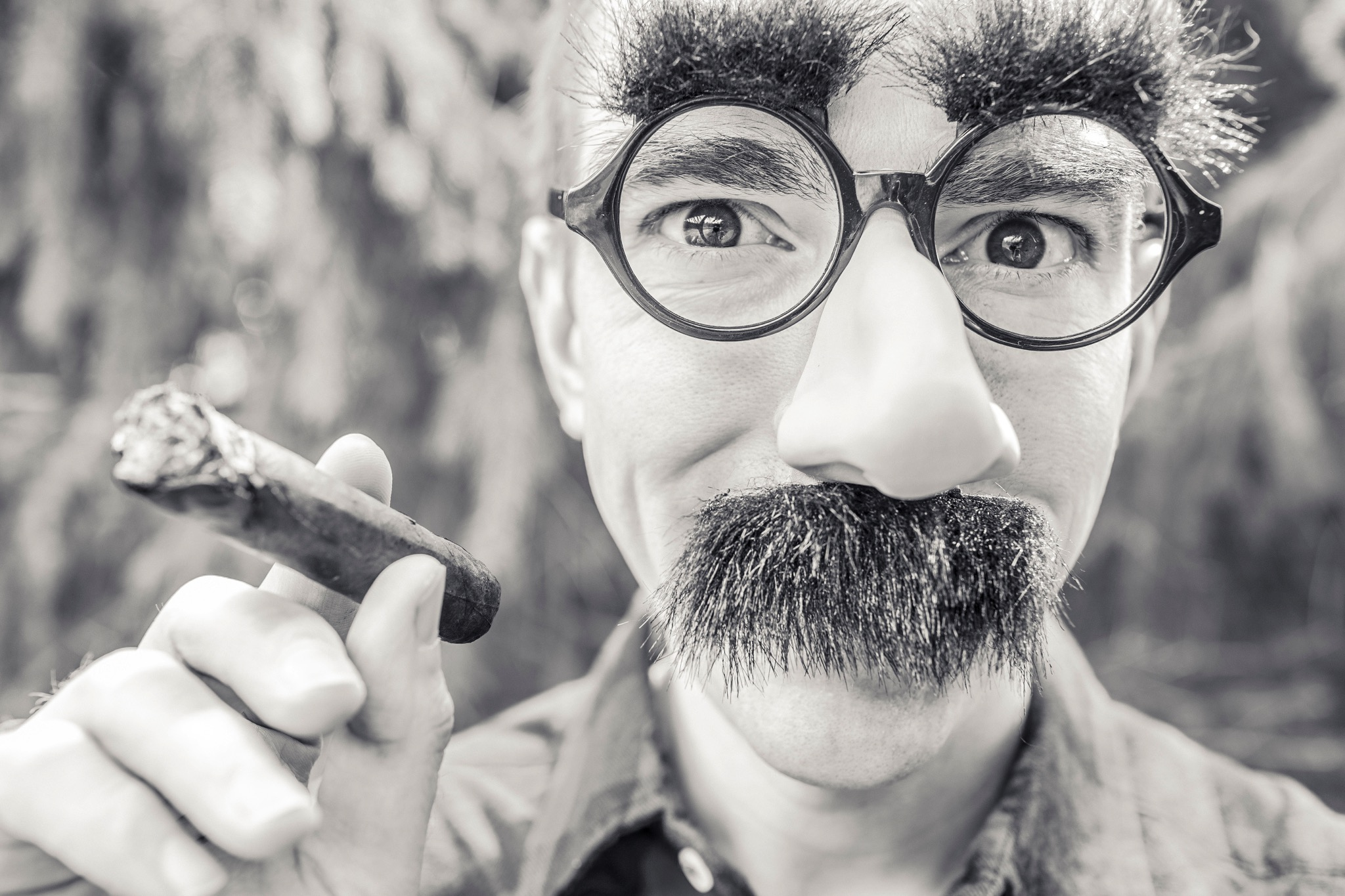 Man wearing fake glasses and moustache